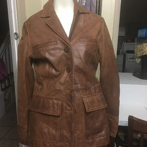 Brown to pocket of the jacket by Mossimo